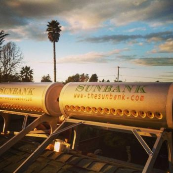 photo showing a residential solar water heater being installed on a rooftop in california