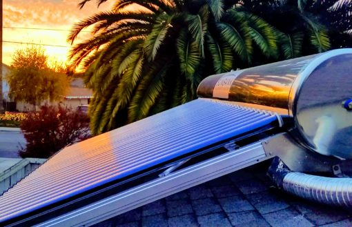 Sunset photo of a Sunbank Solar water heater flush mounted on a comp shingle roof